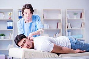 Man receiving a neck massage
