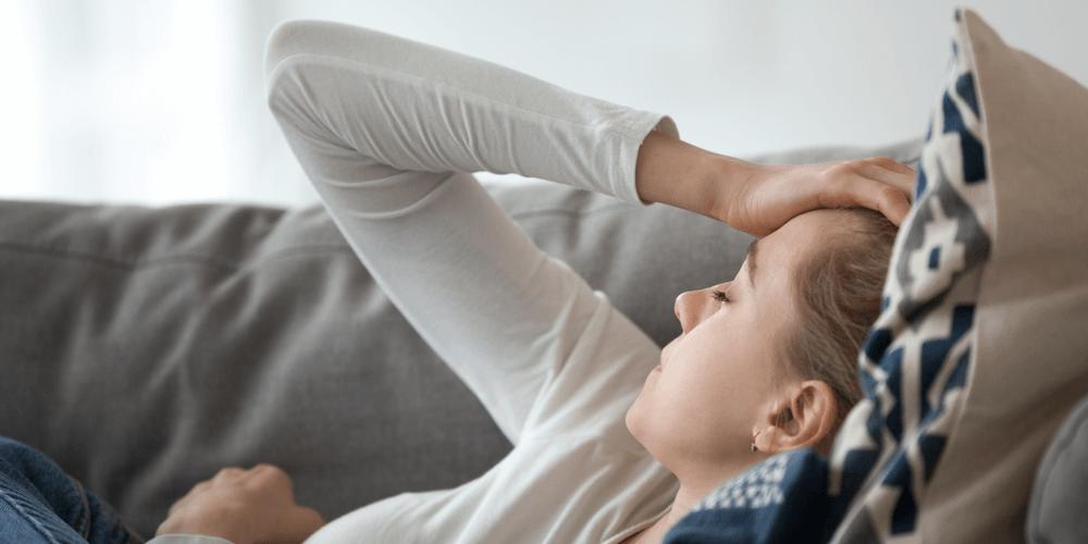 woman suffering with headache