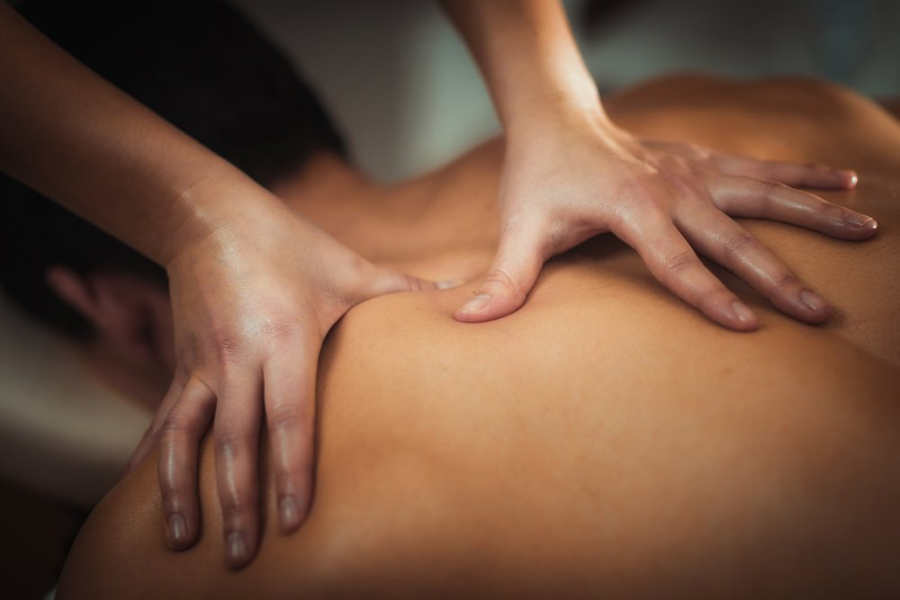 man receiving massage from massage therapist
