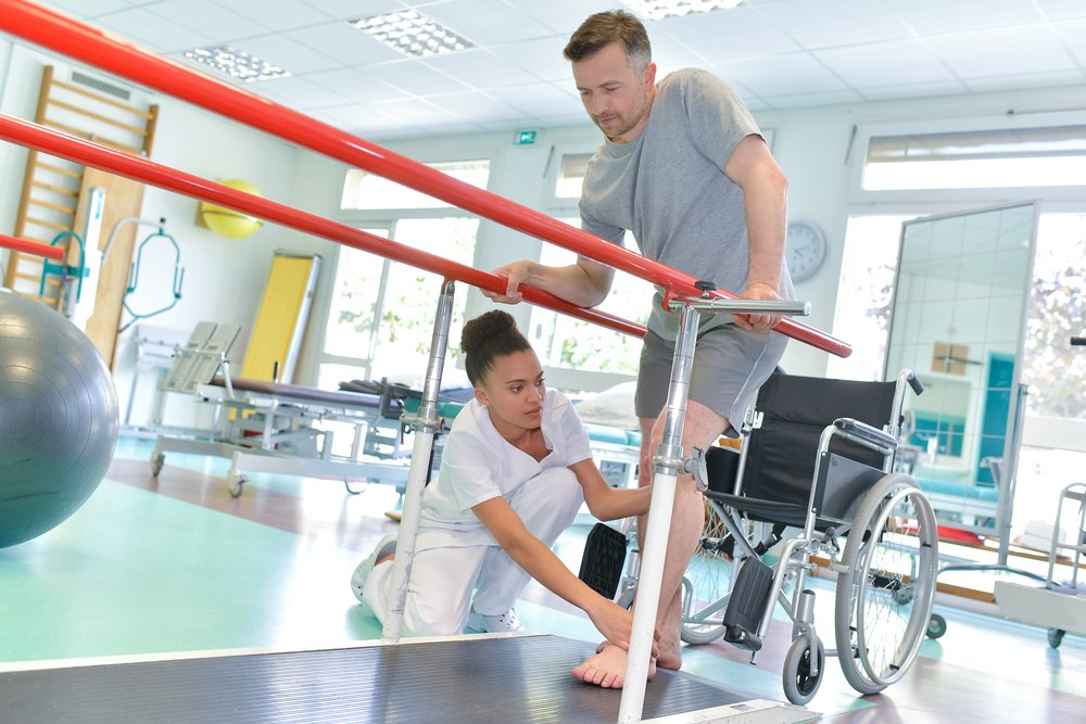 man improving his ability to walk with physical therapy