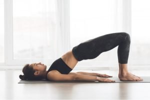 woman doing a bridge stretching exercise