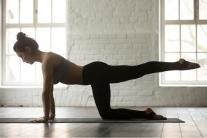 woman performing hip extension stretch