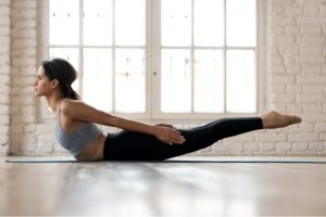 woman performing superman stretch exercise